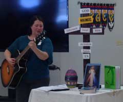 Nicole Playing Guitar at Brillion Deaf Disabilities Retreat 2018